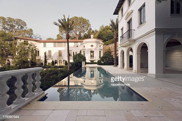 Exterior photo of a Bel Air mansion featuring a pool