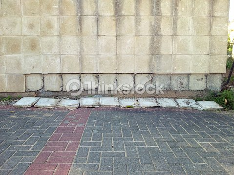 Exterior Porcelain Tiles Falling Off Wall Stock Photo | Thinkstock