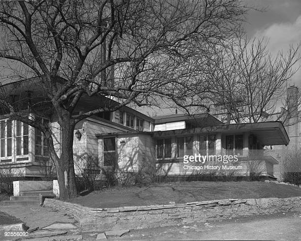 Exterior side view of house from the street showing the Oscar Steffens house in Chicago IL 1963 Designed by Frank Lloyd Wright the house was a...