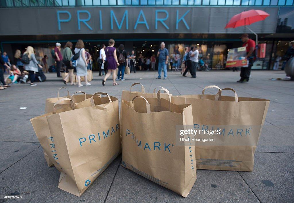 exterior view department store primark on alexanderplatz in berlin in the foreground primark grocery bags - Primark Online Bewerbung