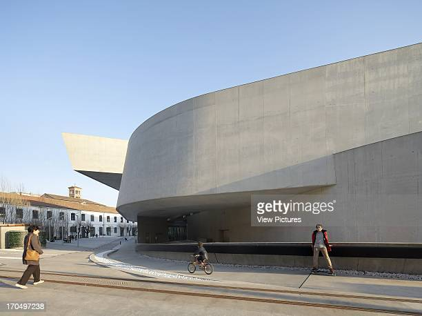 Exterior view of concrete facade with skateboarder MAXXI National Museum of the 21st Century Arts Art Gallery Europe Italy Zaha Hadid Architects