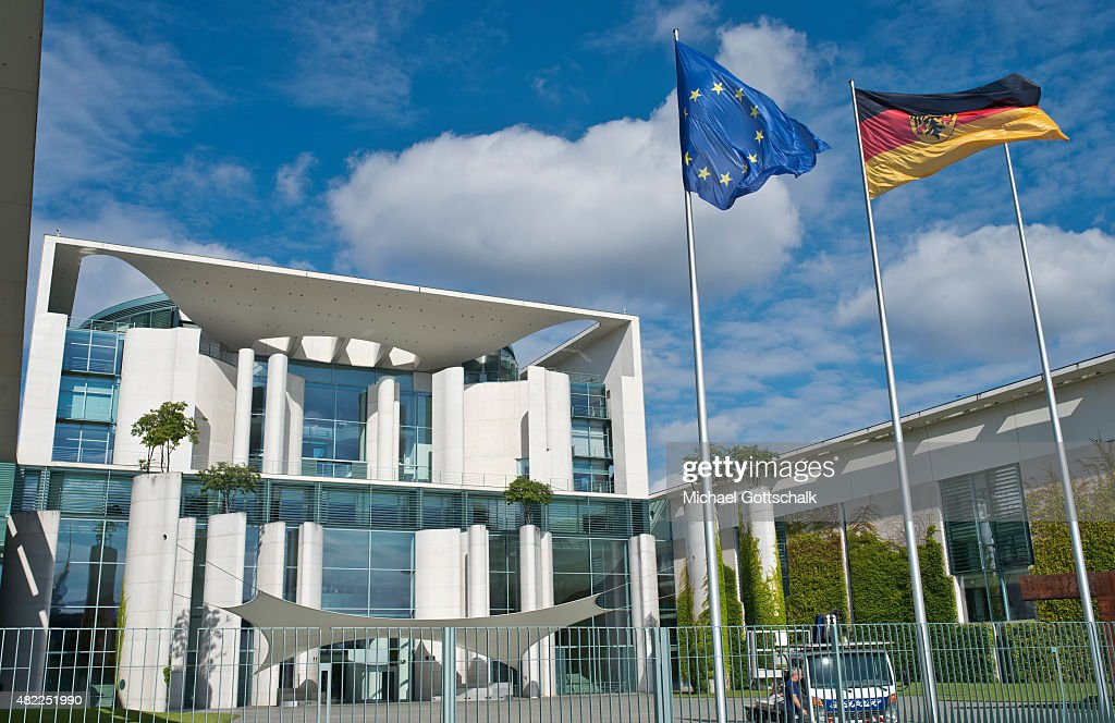 Exterior View of German Chancellery or Bundeskanzleramt with flags of the European Union and Germany in the Ehrenhof on July 29 2015 in Berlin Germany