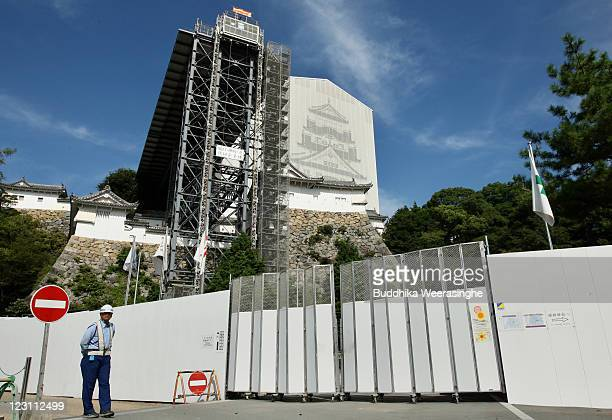 Exterior view of Himeji Castle while undergoing restoration work on August 31 2011 in Hemeji Japan Built between the 14th and 17th centuries and...