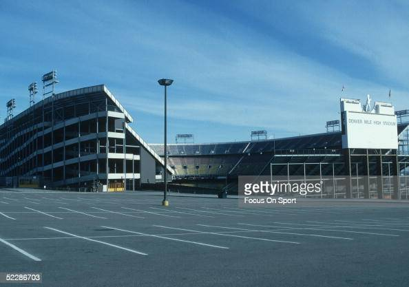 Exterior view of Mile High Stadium from the parking lot circa 1970's in Denver Colorado