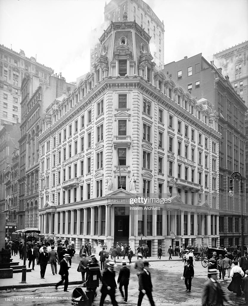 Exterior view of the elegant Second Empire style Drexel Building, designed by the architect Arthur Gillman and home of the offices of J.P. Morgan and Company, New York, early twentieth century. Located at 23 Wall Street, on the southeast corner of Wall and Broad Streets, it was demolished in 1913 to make way for Trowbridge and Livingston's design for JP Morgan's headquarters.
