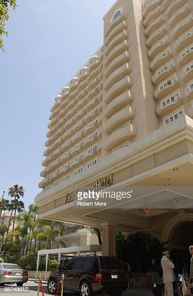 Exterior view of the main entrance into the Four Seasons Hotel Beverly Hills California June 1 2002 A uniformed valet is visible at the lower right...