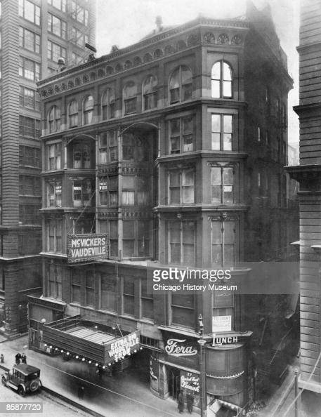 Exterior view of the McVickers Theater located at 25 WMadison Street in Chicago with signs advertising its 'Extra Big Vaudeville Show' 1920s