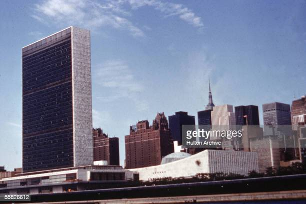 Exterior view of the United Nations Headquarters building and surrounding midtown area as seen looking West from the East River New York New York...