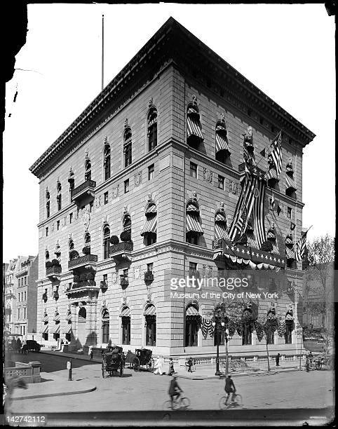 Exterior view of the University Club decorated with striped bunting New York New York early 1900s American Admiral George Dewey served as the Club's...