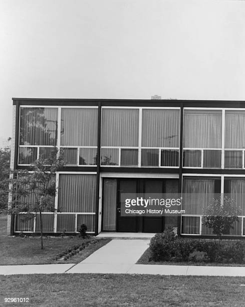 Exterior view showing the entrance doors to 2 townhouses and sidewalk part of the Lafayette Park development in Detroit MI 1974 The complex which...