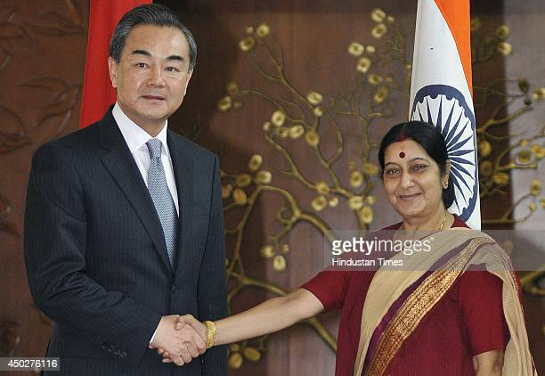External Affairs Minister Sushma Swaraj and Chinese Foreign Minister Wang Yi before a meeting to discuss ways to make IndoChina bilateral relations...