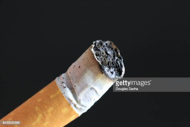 Extinguished Cigarette on black background
