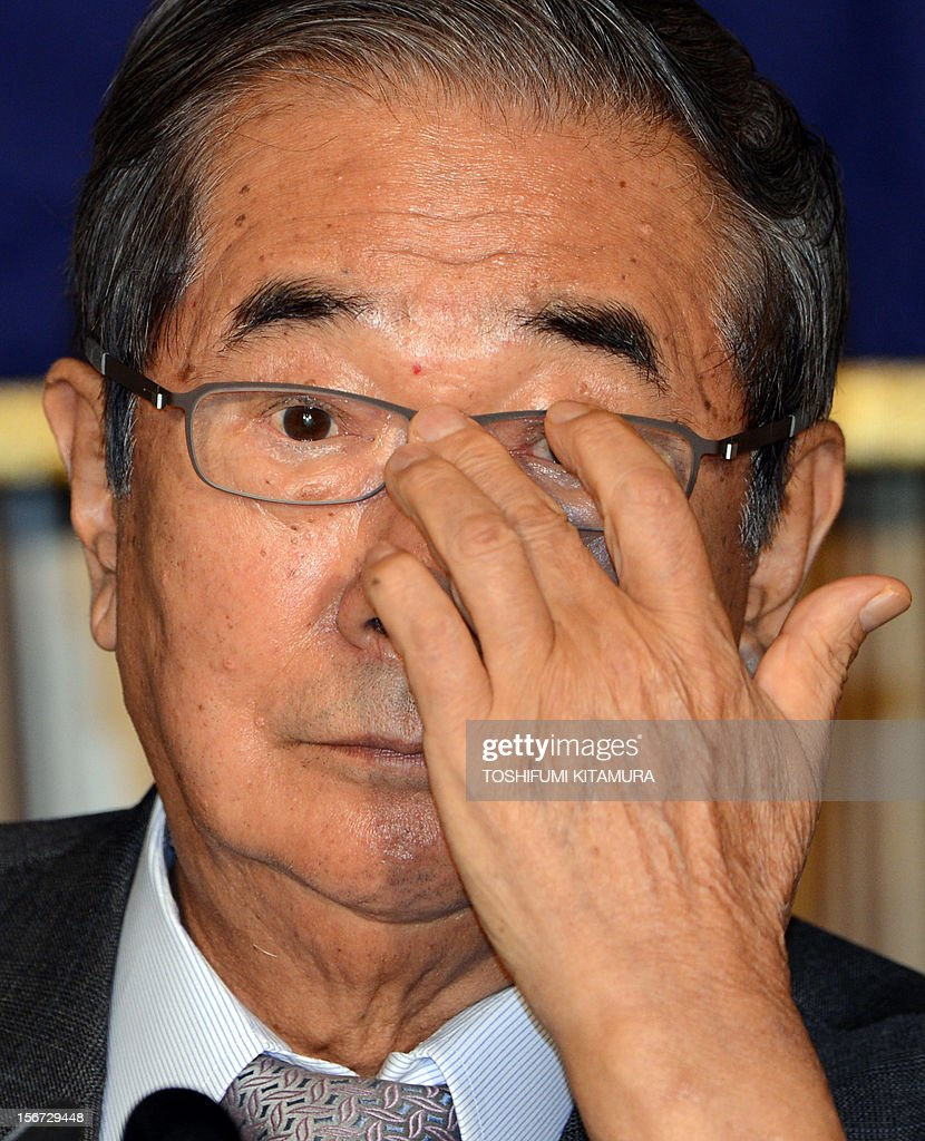 Ex-Tokyo governor Shintaro Ishihara adjusts his glasses during his FCC professional luncheon in Tokyo on November 20, 2012. Controversial ex-Tokyo governor Shintaro Ishihara addressed foreign media after joining forces with Osaka mayor Toru Hashimoto to forge a 'third force' ahead of snap general elections.