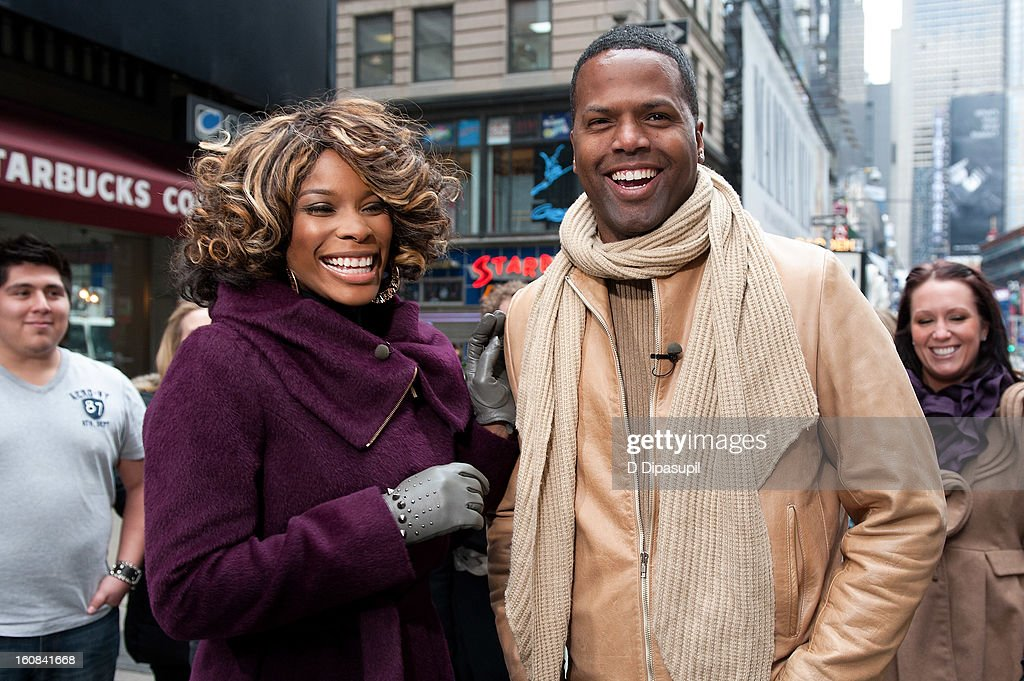 'Extra' correspondent AJ Calloway (R) interviews DJ K. Foxx during a taping of 'Extra' in Times Square on February 6, 2013 in New York City.