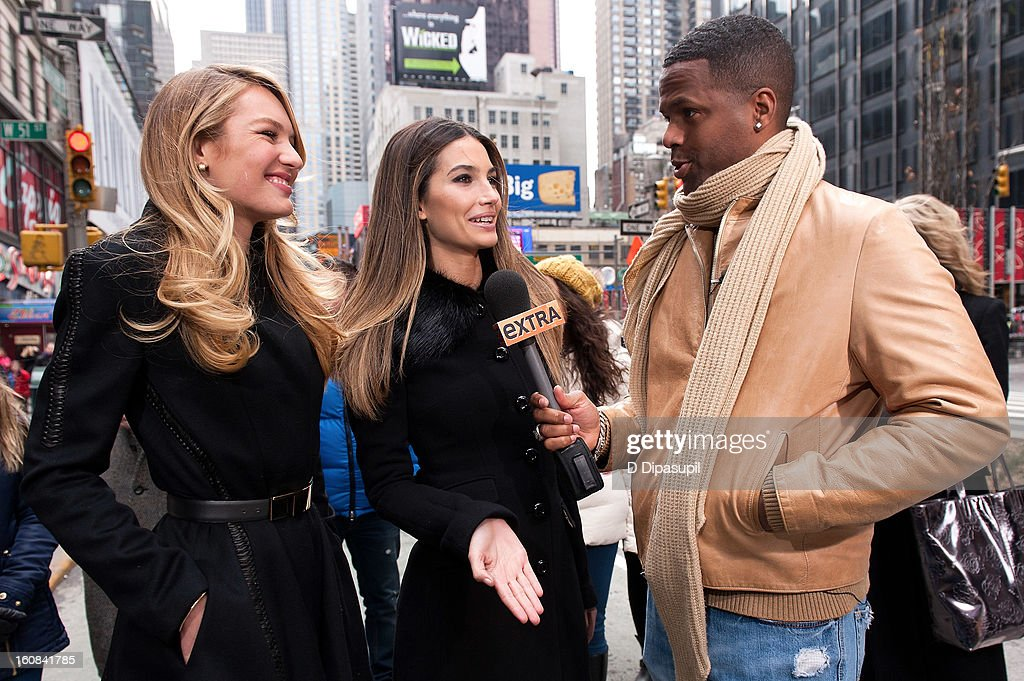 'Extra' correspondent AJ Calloway (R) interviews Victoria's Secret models <a gi-track='captionPersonalityLinkClicked' href=/galleries/search?phrase=Candice+Swanepoel&family=editorial&specificpeople=4357958 ng-click='$event.stopPropagation()'>Candice Swanepoel</a> (L) and <a gi-track='captionPersonalityLinkClicked' href=/galleries/search?phrase=Lily+Aldridge&family=editorial&specificpeople=2110490 ng-click='$event.stopPropagation()'>Lily Aldridge</a> during a taping of 'Extra' in Times Square on February 6, 2013 in New York City.
