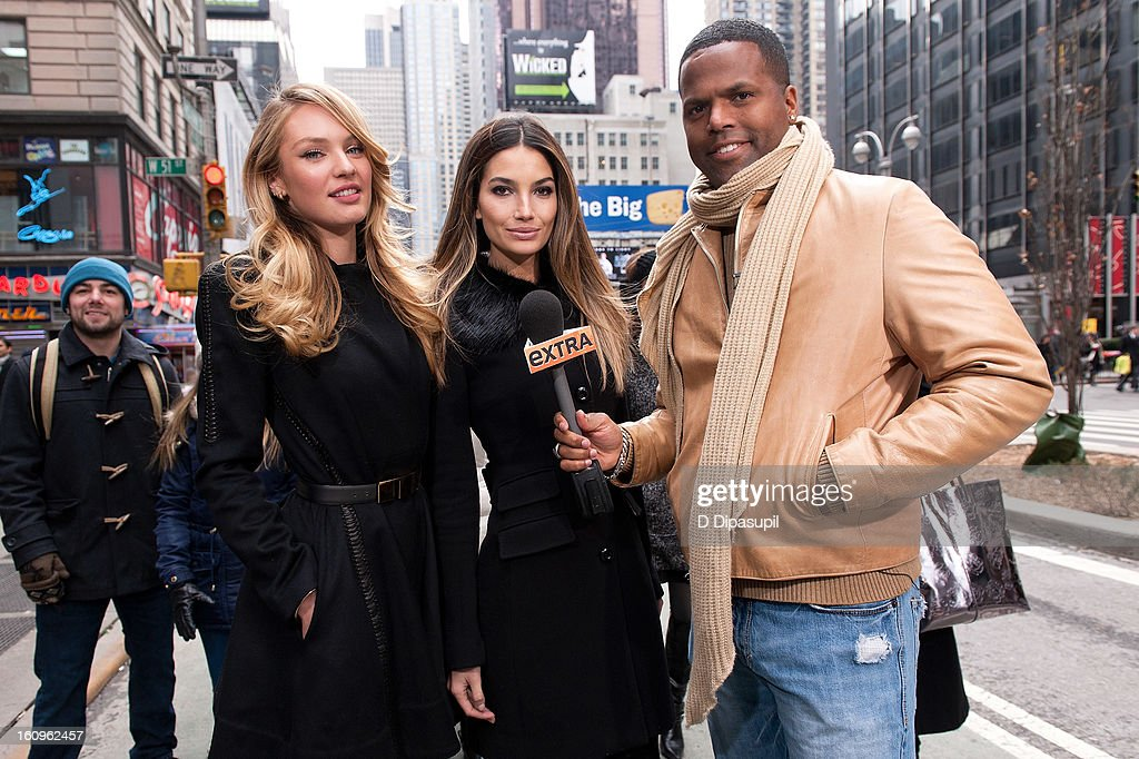 'Extra' correspondent AJ Calloway (R) interviews Victoria's Secret models Candice Swanepoel (L) and Lily Aldridge during a taping of 'Extra' in Times Square on February 6, 2013 in New York City.