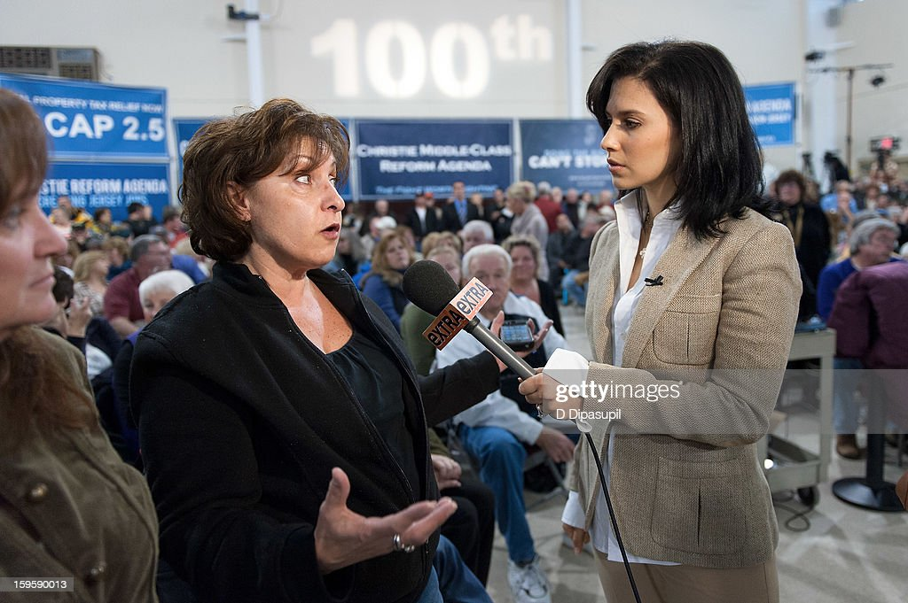 'Extra' Lifestyle Correspondent Hilaria Baldwin (R) interviews guests at New Jersey Governor Chris Christie's 100th Town Hall Meeting at St. Mary's Parish Center on January 16, 2013 in Manahawkin, New Jersey.
