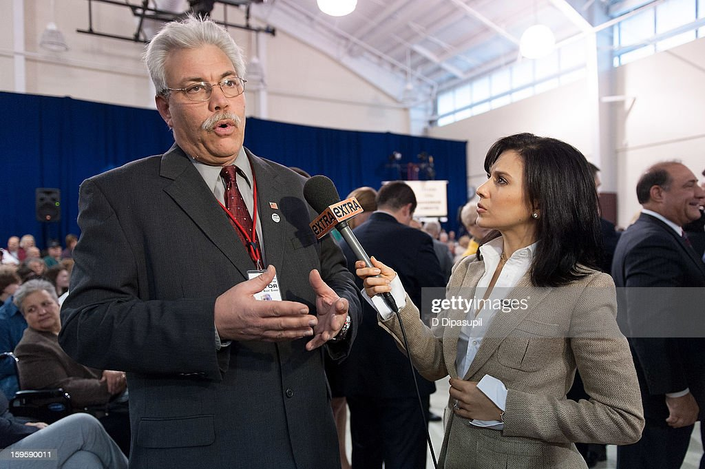 'Extra' Lifestyle Correspondent Hilaria Baldwin (R) interviews Tuckerton, New Jersey mayor George 'Buck' Evans at New Jersey Governor Chris Christie's 100th Town Hall Meeting at St. Mary's Parish Center on January 16, 2013 in Manahawkin, New Jersey.