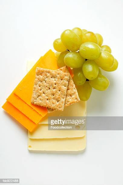 Extra Sharp Cheddar & American cheese with grapes, cracker