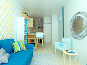 Very small modern studio flat with blue sofa, cozy kitchen  and bright details