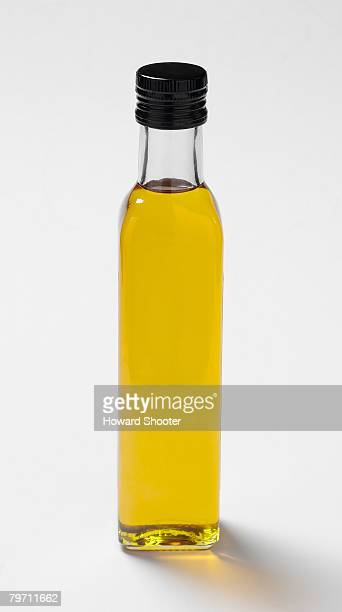 Extra virgin olive oil in a bottle, close up
