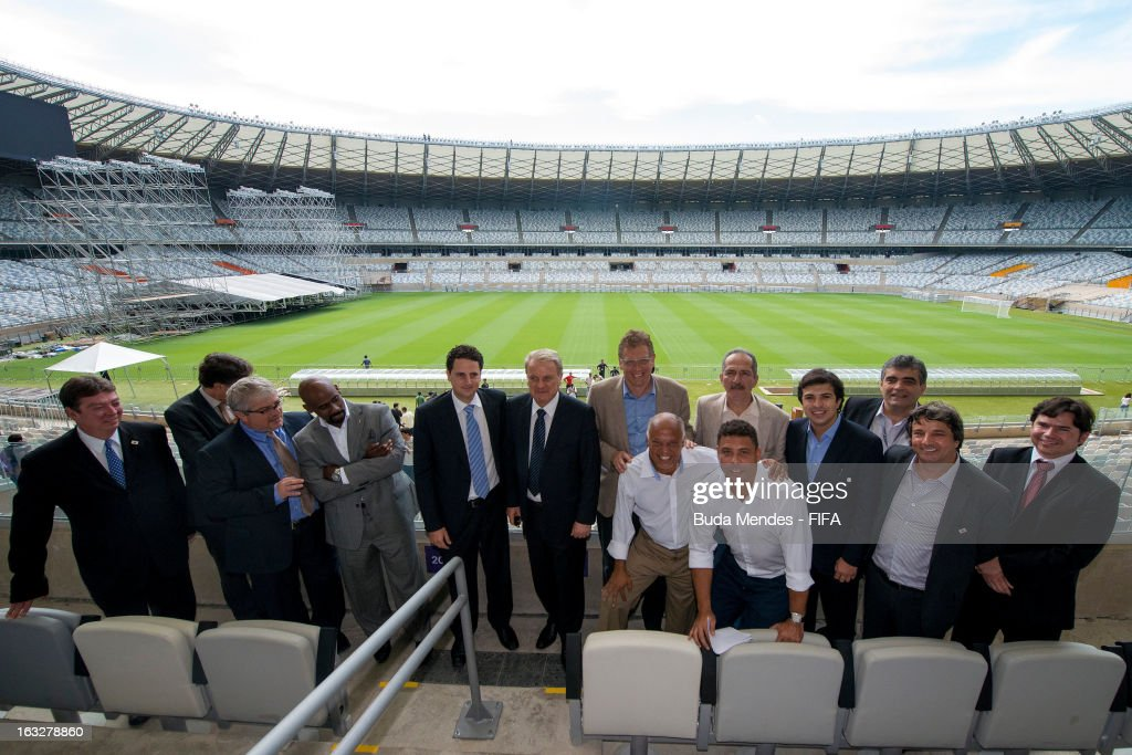 Extraordinary Secretary of Minas Gerais for the FIFA World Cup Tiago Lacerda, Mayor of Belo Horizonte Marcio Lacerda, FIFA Secretary General Jerome Valcke, former player Reinaldo, LOC member Ronaldo Nazario, Brazil's Sports Minister Aldo Rebelo and other members of the LOC and FIFA pose for a photo during a visit to Mineirao Stadium during the 2014 FIFA World Cup Host City Tour on March 6, 2013 in Belo Horizonte, Brazil.