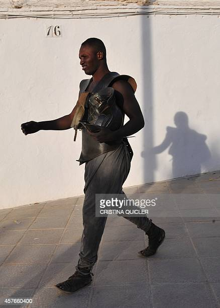Extras acting in the series of the Game of Thrones leave the bullring on October 22 2014 as film crews began shooting part of the fifth season of the...