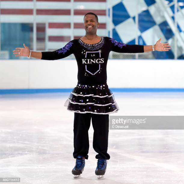 Extra's AJ Calloway loses his Stanley Cup bet to Mario Lopez at Sky Rink at Chelsea Piers on June 16 2014 in New York City