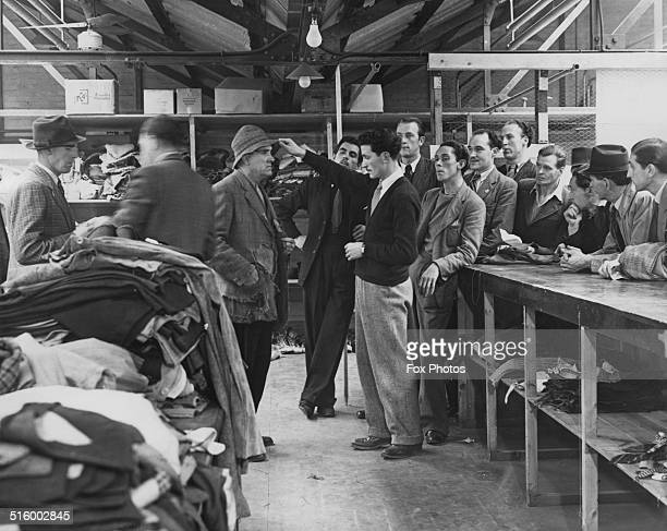 Extras being fitted with costumes at Pinewood Studios on the set of the film 'Captain Boycott' Buckinghamshire UK September 1946