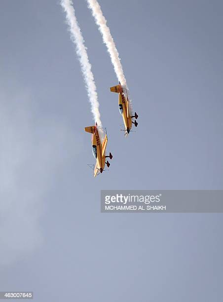 DHL Extras display team perform during the opening of the Bahrain International Airshow 2014 in Sakhir south of the capital Manama on January 16 2014...