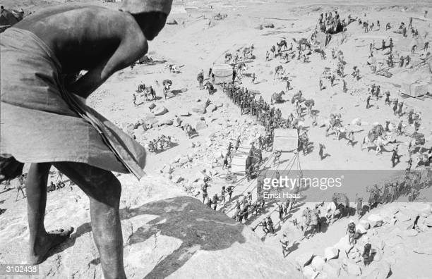 Extras filming a scene on location in Egypt for Howard Hawks' film 'The Land Of The Pharaohs'