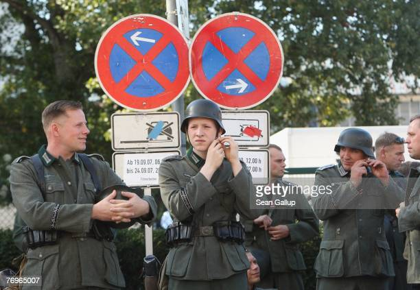 Extras in World War IIera German military uniforms stand near the set of 'Valkyrie' outside the Bendler Block September 23 2007 in Berlin Germany The...