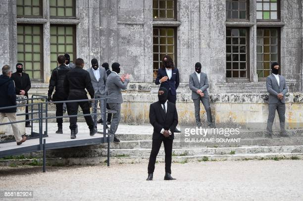 Extras stand at the Chateau of Chambord on October 5 2017 during the shooting of the Indian action film 'Junga' The film in Tamil features Vijay...