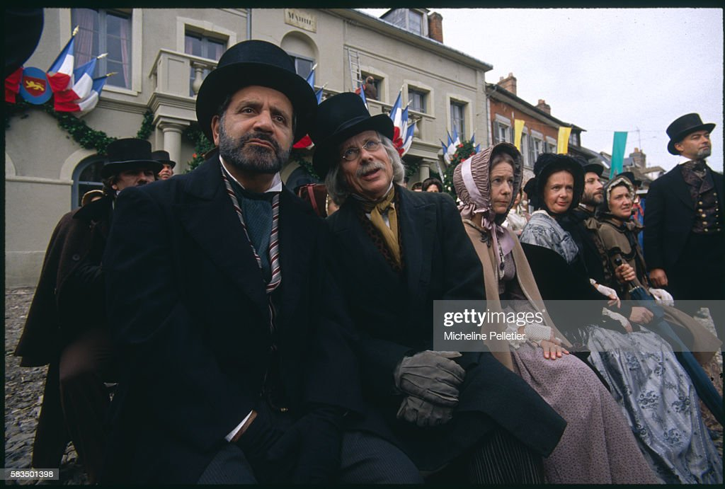 Extras waiting on the set including French actors Jean Yanne and JeanFrancois Balmer