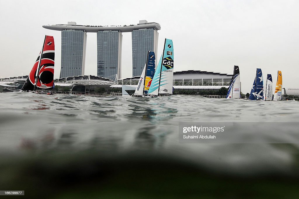 Extreme 40 fleets race during day one of the Extreme Sailing Series at Marina Bay Reservoir on April 11, 2013 in Singapore.