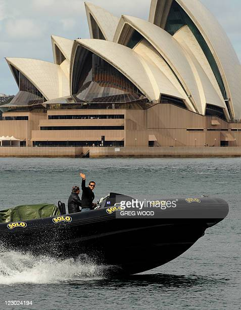Extreme adventurer and 'Man Vs Wild' star Bear Grylls passes the Sydney Opera House in an SAS speed boat as he arrives for a promotional event on...