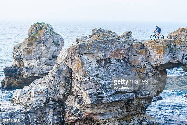 Extreme biker on top of the cliff