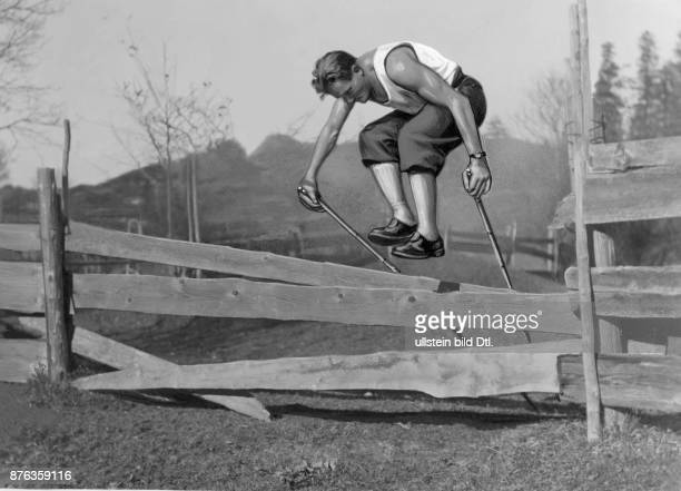 Extreme climber mountain guide skier Germany Emil Solleder presents a jump over a wooden fence dry run for the skiing Vintage property of ullstein...