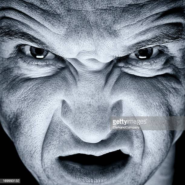 Extreme Close Portrait of the Face of an Angry Man