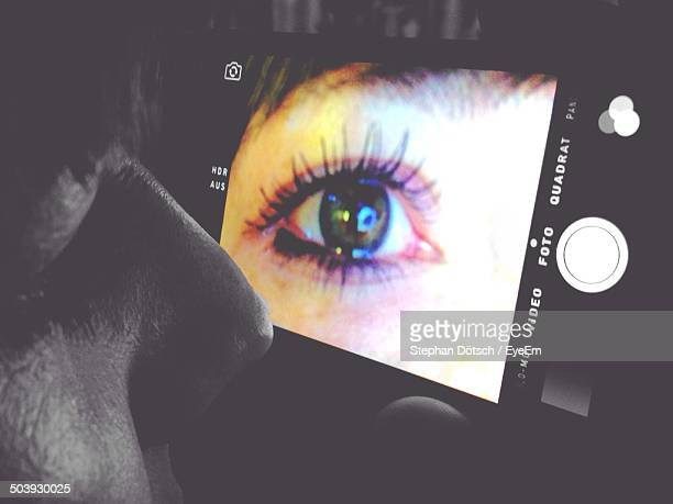 Extreme close up of human eye on camera screen