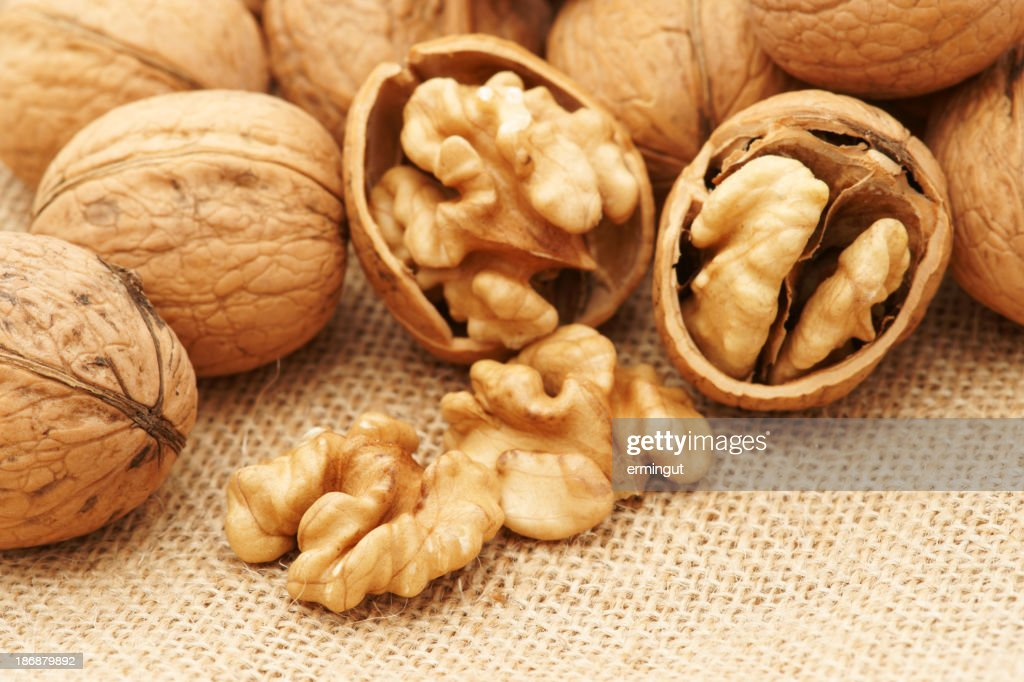 Extreme close up of walnuts with some cracked open : Stock Photo