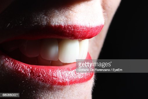 Extreme Close Up Of Woman With Red Lips