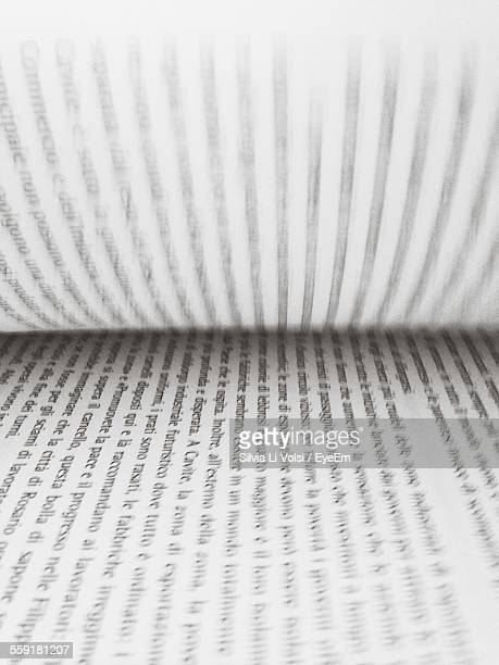 Extreme Close-Up Of Open Book With Turning Pages
