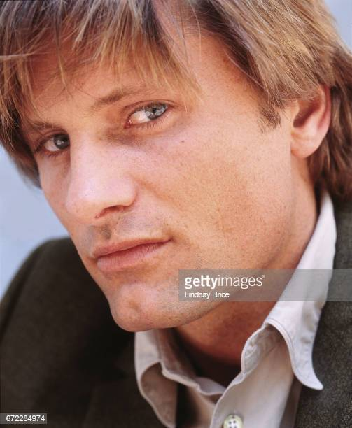 Extreme closeup view of Viggo Mortensen wearing a tan buttondown shirt and a sport coat as he looks into the lens during a photo session on April 13...
