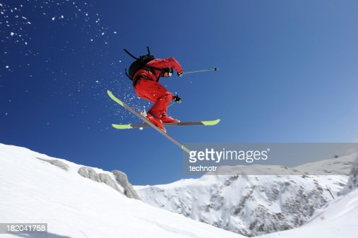 Extreme free ride skier in mid air