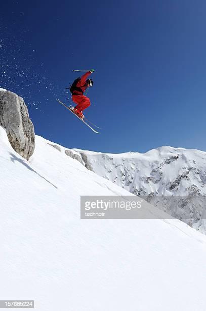 Extreme free ride skier jumping