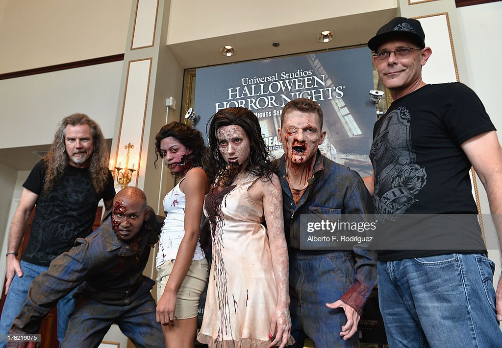 Extreme horror make-up artist Larry Bones (L), zombies and 'Halloween Horror Nights' creative director John Murdy attend Universal Studios' 'Halloween Horror Nights' media make-up kick-off at The Globe Theatre on August 27, 2013 in Universal City, California.