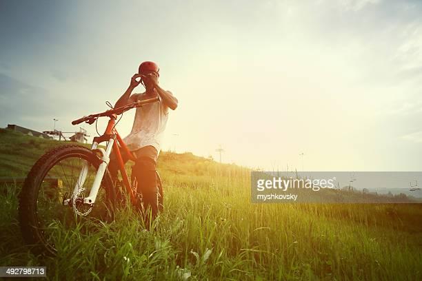 Extreme mountain biker at sunset.