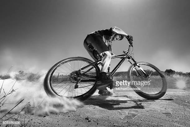 B&W Extreme Mountain Biker Jumping Off A Cliff