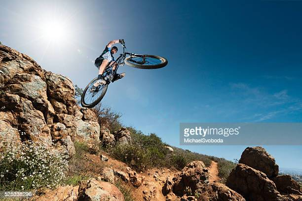Extreme Mountain Biker Jumping Off A Cliff